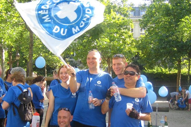 Ride participants fly the flag for Medecins du Monde in Paris