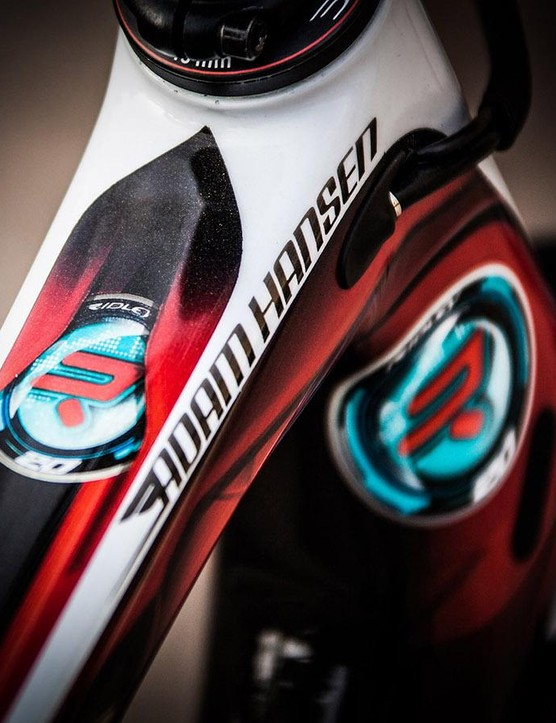 Custom paint and a roundel inspired by Iron Man and commemorating Hansen's 20th Grand Tour start adorn the bike