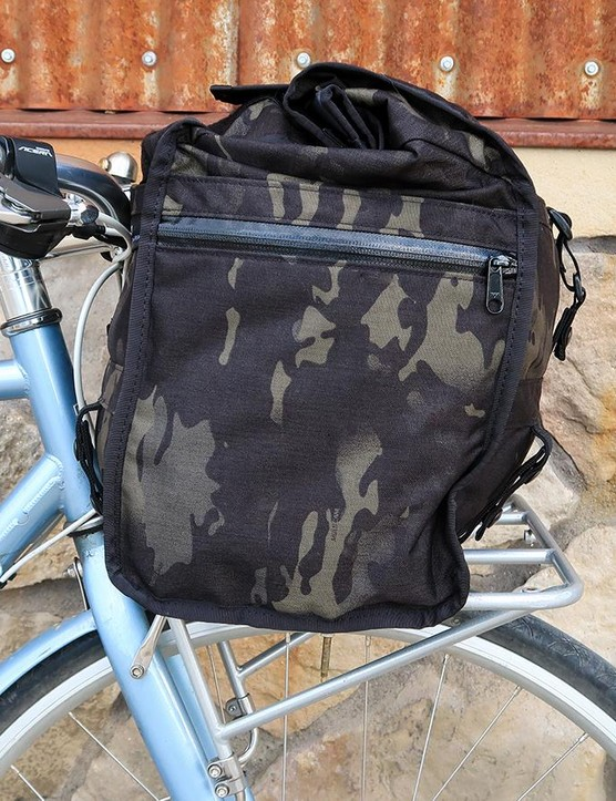 Mission Workshop's Helmsman Duffel can be mounted to a front rack or carried with a shoulder strap