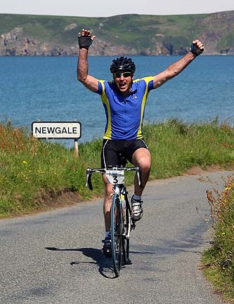 Paul Colman, rather pleased to get to the top at Newgale