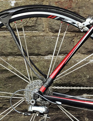 Mudguards/fenders will ensure you get to work without a wet stripe up your back