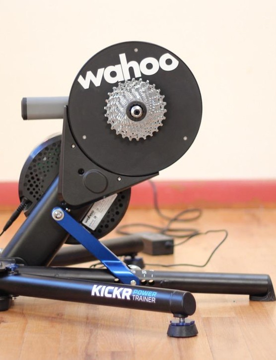 The feet adjust for height and then lock in place. The trainer is very sturdy and does not wobble. I like the fact that you don't need a wheel tray