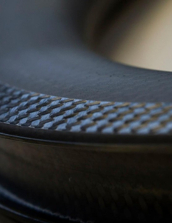 After years of being cautious about full-carbon clinchers, Mavic developed a proprietary curing process that allows for high heat from braking