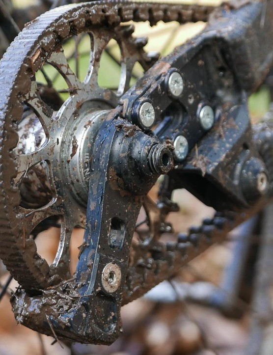 This is the 'snubber' which helps ensure the belt doesn't lift from the rear sprocket
