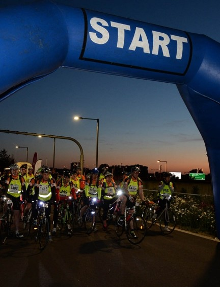 Nightrider events see hundreds of cyclists ride through British cities at night for charity