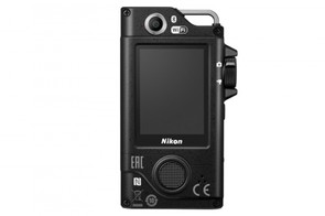 The camera features front and rear facing cameras and an LCD touchscreen on the back