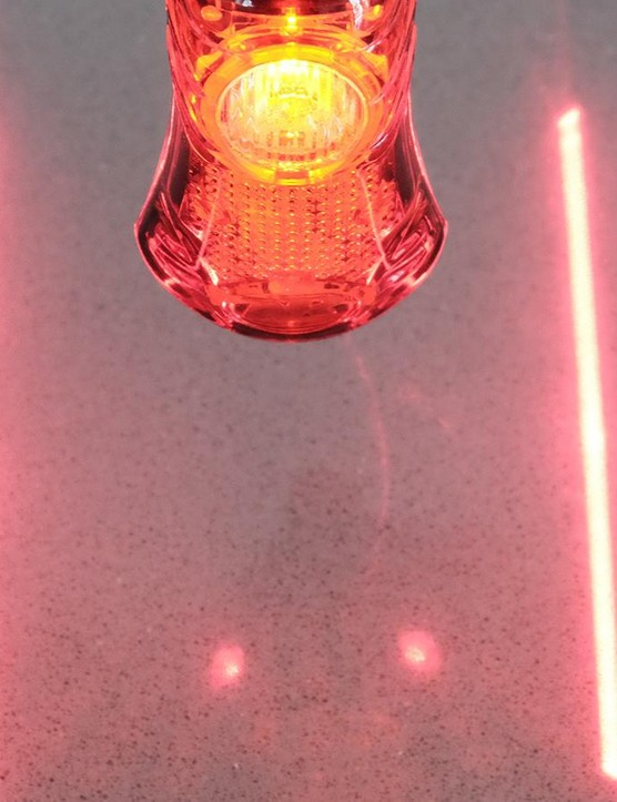 It has freakin' laser beams to create your own virtual bike lane!