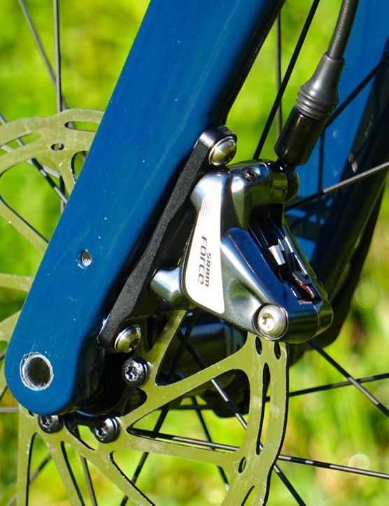 The fork is 100x12mm thru axle, flatmount and can accommodate fenders