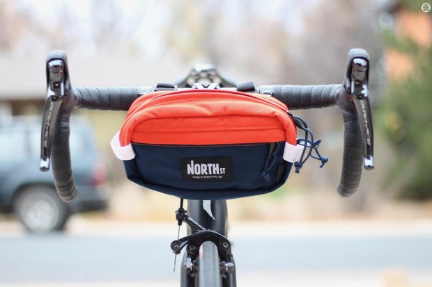 The North St Pioneer 9 Hip Pack works very well as a handlebar bag