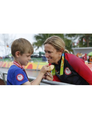 Three-time Olympic gold medalist Kristin Armstrong with her son Lucas in Rio