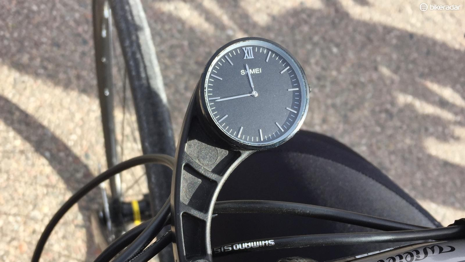 A friend made this analog ride computer for $18 ($4 watch plus a $14 Garmin tab repair kit) — and he rides with his Wahoo Elemnt in his jersey to collect data