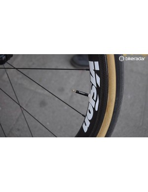Wheel decals double up to prevent the tyre valves rattling in the rim over the cobbles