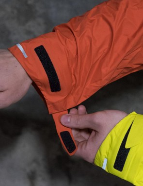 The cut over the wrists is great, plus there's Velcro for added adjustability, and reflective strips