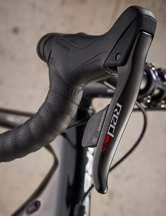 The shiny black carbon of the SRAM Red kit complements the carbon frame
