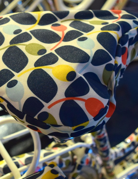 Matching accessories such as this saddle cover are also part of the Olive and Orange range