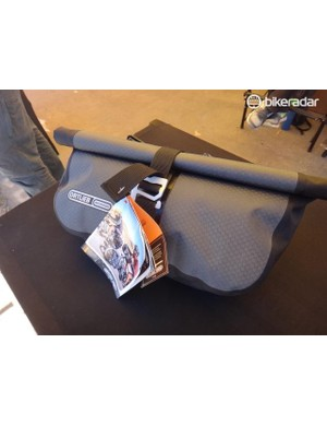 Ortlieb's 3.5L Accessory Pack can be used alone or in conjunction with the Handlebar Pack. Ortlieb claims it is the first ever waterproof roll top pocket bag. Off the bike, the $70 bag, can be carried using an included shoulder strap
