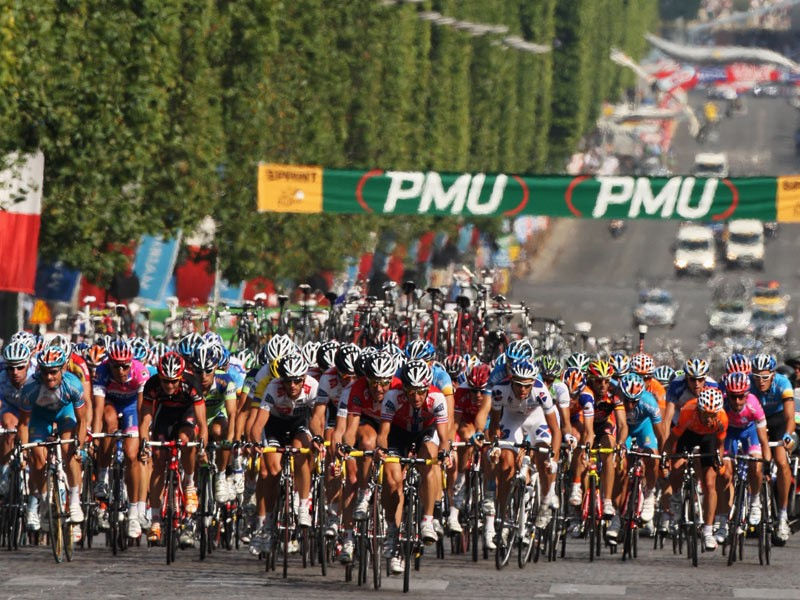 The peloton makes its way along the Champs Elysees during Stage Twenty One of the Tour de France on July 27, 2008 in Paris, France