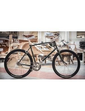 The British Racing Green Pashley-Morgan 3 features a Reynolds 631 chromoly frame and a Sturmey-Archer 3-speed internally geared rear hub