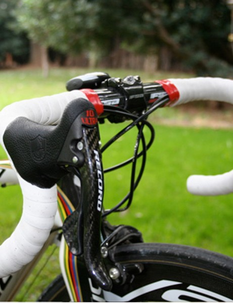 Bettini uses Campagnolo's new 'Red' version of its Record Ergopower levers.