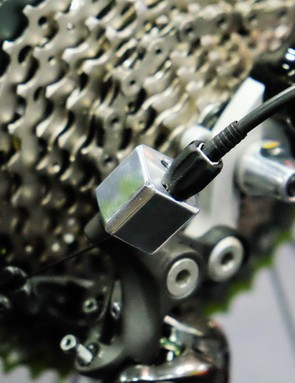 Phil Wood used an offset adapter to increase the cable pull capacity of the 11-speed Shimano derailleur