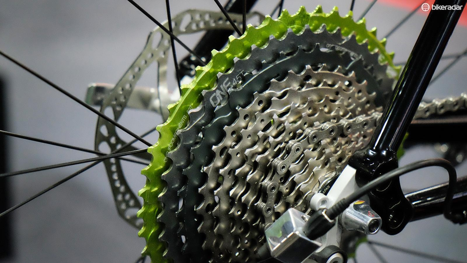 OneUp's 45 and 50t upgrade cogs have been added to an 11-speed cassette to get the extra range