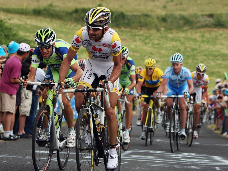Leonardo Piepoli of Italy and Saunier Duval leads the yellow jeresy group up the Saint-Jean-de -Donne climb during stage seven of the 2008 Tour de France from Brioude to Aurillac on July 11, 2008 in Aurillac, France