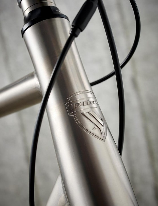 Tapered head-tube bears the Pilot badge