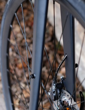 The full carbon fork gets internal cable routing