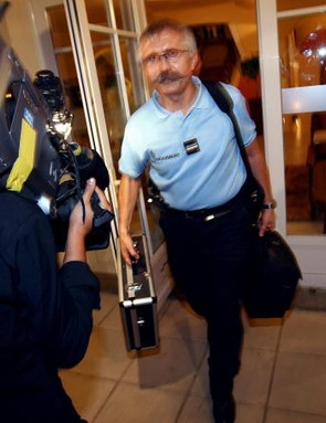 French gendarmes leave the Palmerai Hotel in Pau, 24 July 2007, after it was revealed that Kazakhsta