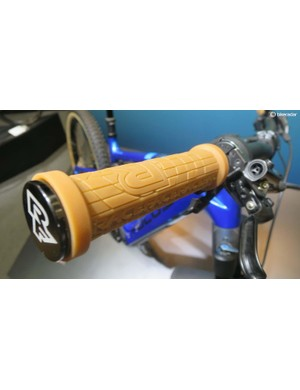 We like the natural rubber RaceFace grips to match the skinwall Schwalbe rubber