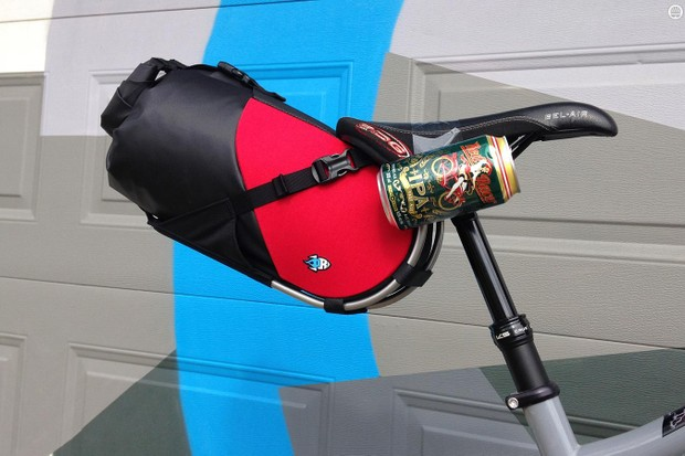 Porcelain Rocket's Dropper Fusion will let bikepackers get rowdy in the woods. (The beer can is obscuring the seatpost mount, which is being refined before the pack hits the market later this year)