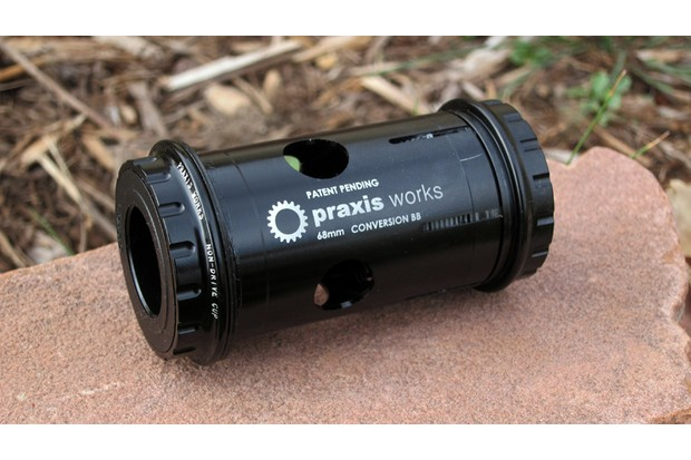 Numerous adaptors are available to convert from one bottom bracket system to another, but all-in-one units like this one from Praxis minimizes the number of parts and, thus, the chance of creaking. Praxis's BB/PF30-to-24mm conversion bottom bracket also incorporates a trick collet system that expands outward to firmly lock itself in the frame