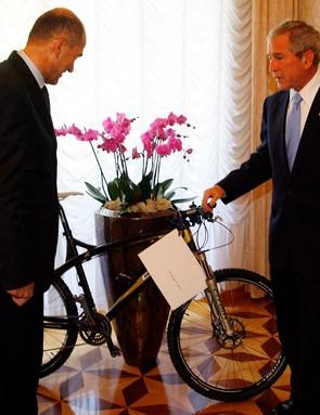 President Bush receives a new mountain bike in Slovenia.