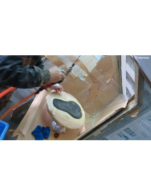 Saddle covers are sprayed with a bonding agent before being set on the pad