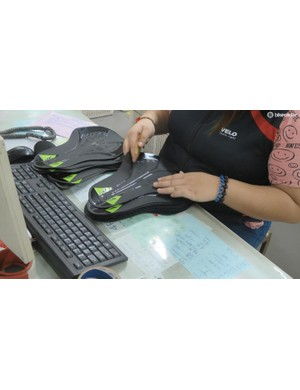 Printed saddle covers are checked for quality and colour matching before going into the production line