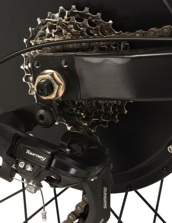 A 7-speed Shimano Tourney rear derailleur provides the gears