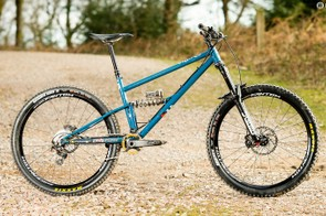 Full suspension enduro bike, in steel, with a coil shock. It's a niche wrapped in a mystery, wrapped in an enigma, stuffed in a niche