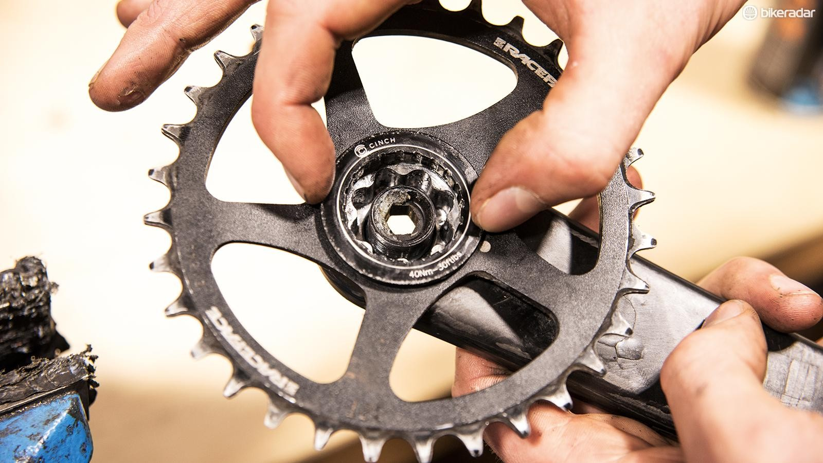 Slot the Cinch onto the splines of the driveside crank arm