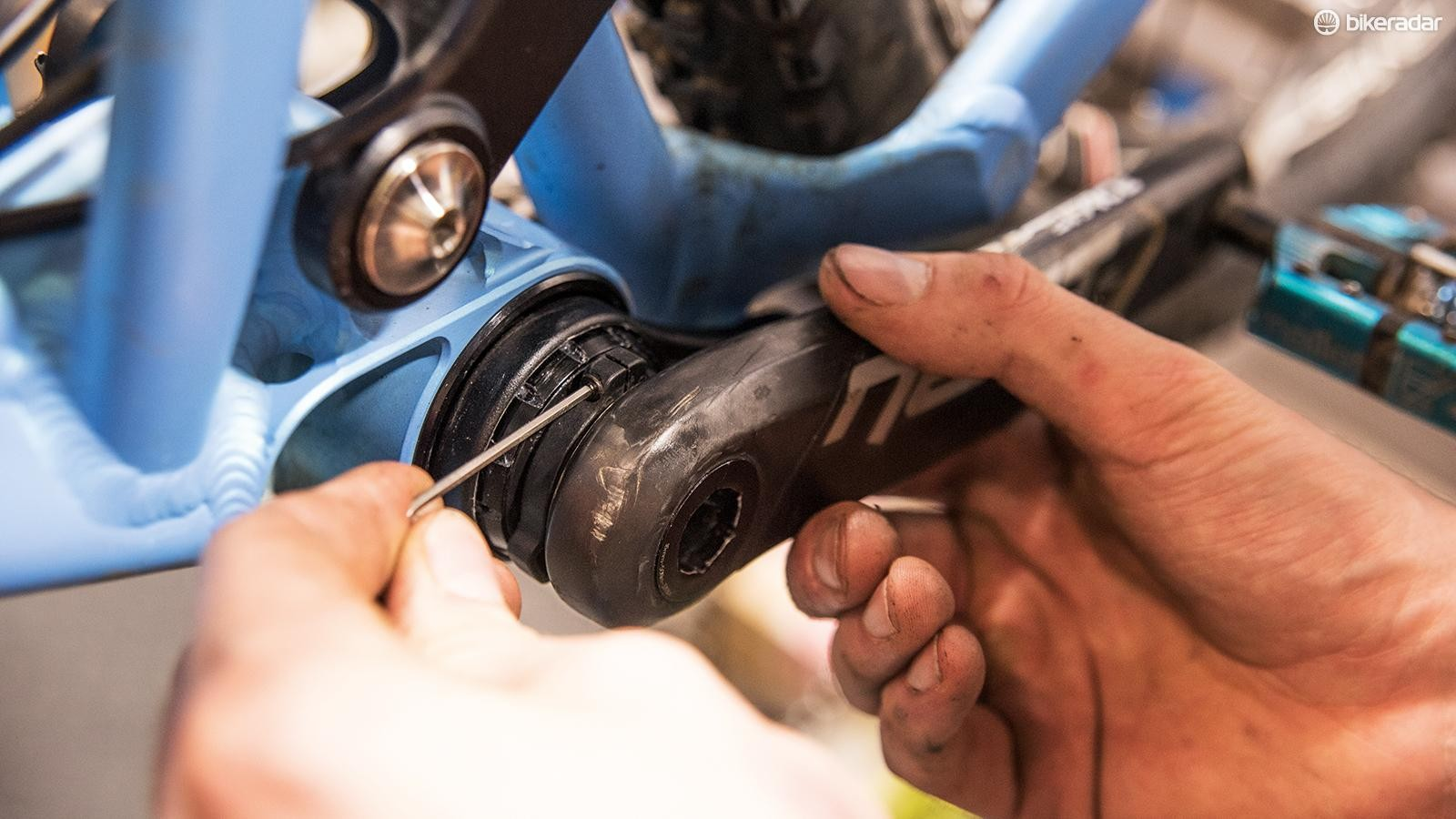 Check the crank arms are free of play and turn smoothly