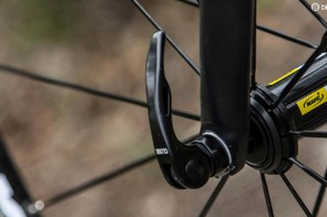 Quick release skewers have an open and closed lever position. Ensure you can read 'Closed' or 'Close' from the outside before riding