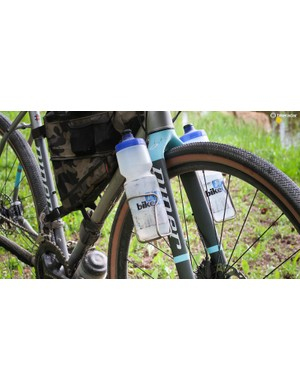 Mounts on the carbon fork legs are handy for carrying cargo or water