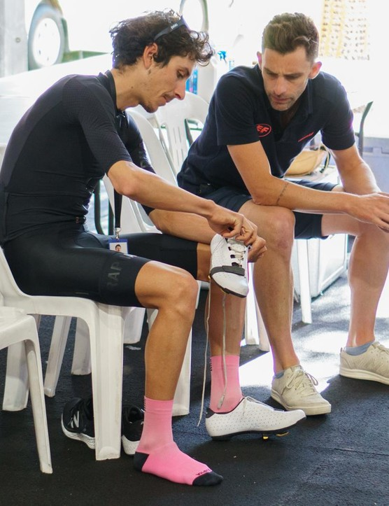 Morton shows off the new shoes to directeur sportif Tom Southam