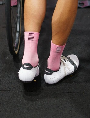 To the rear of the shoe a reflective Rapha logo sits in a black tab on the heel