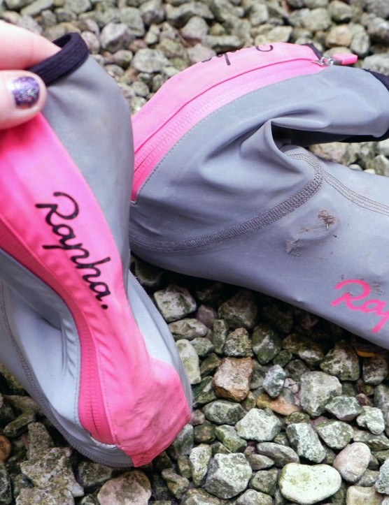 The stretchy bright pink panel up the back conceals the zip