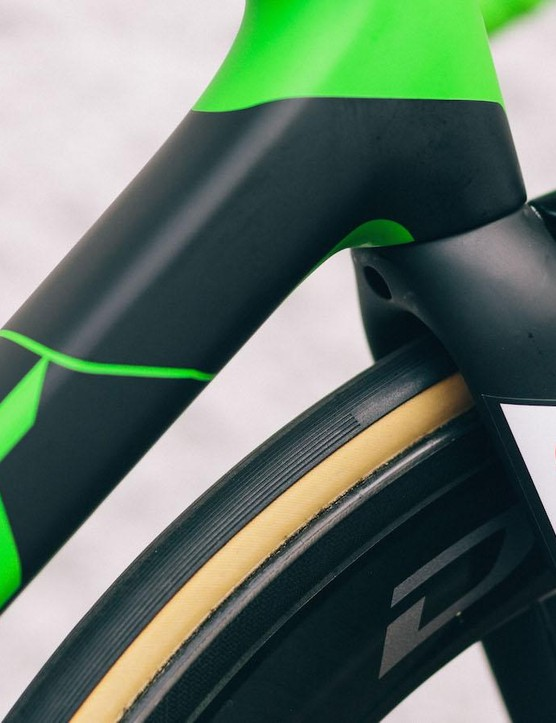 Green detailing throughout the bike