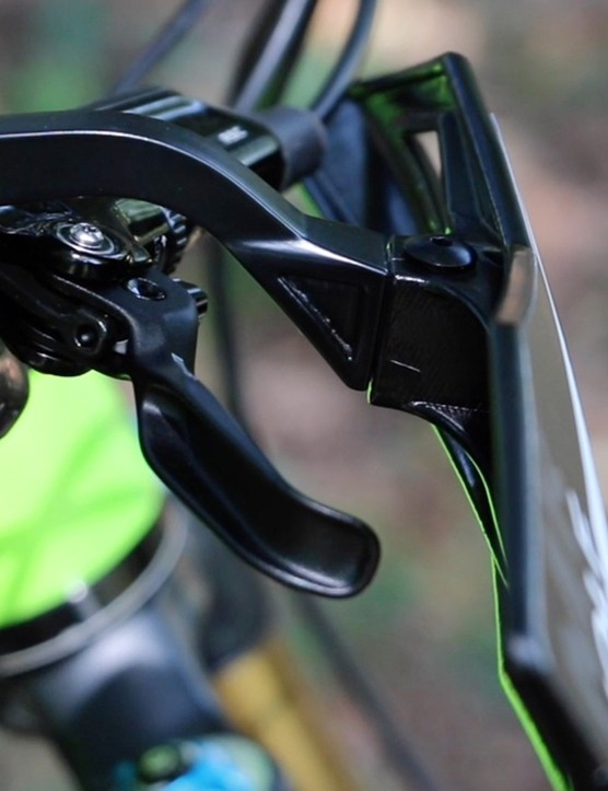 The Recchie handguards mount outboard of the shift and brake levers