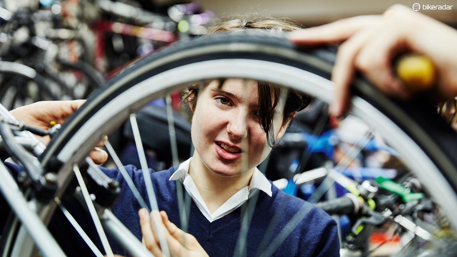 Volunteers work to repair the bikes, learning valuable skills themselves