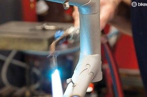 A blowtorch was used to get the seat post out and strip paint off to check for damage
