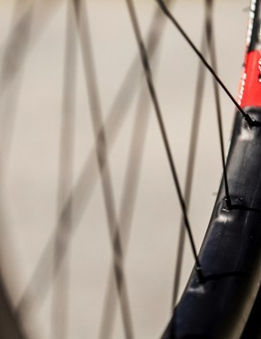 External isolated reinforcements around each spoke eyelet help to make a more consistent, durable rim