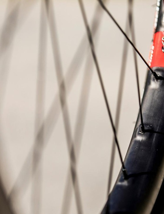 An asymmetrical rim profile and offset spoke holes help to keep spoke tension even and bracing angle equal for a stronger, more durable wheel build